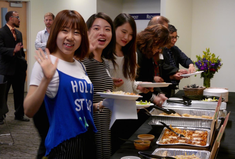 Students waving to camera