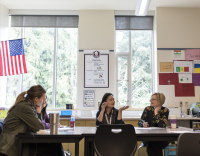 Faculty and students from the University of Washington College of Education gather in a classroom.