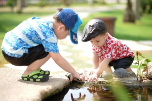 Two children at a pond
